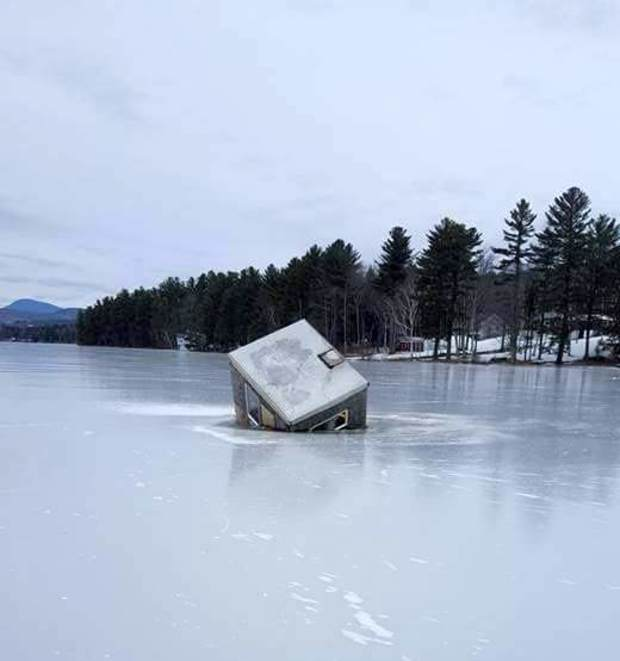 Ice fishing shack falling into lake sinking